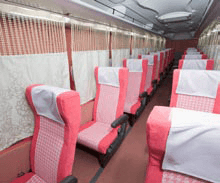 Privacy curtains between seats inside a long distance bus