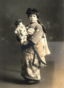 One of the dolls from the U.S. held by a Japanese girl