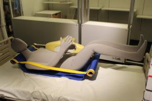 An equipment to carry a bedridden person is under development.