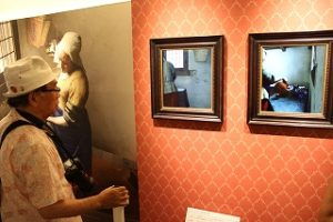 A model produced using a 3D printer enables a person to view areas not shown in the original picture of Johannes Vermeer's The Milkmaid.